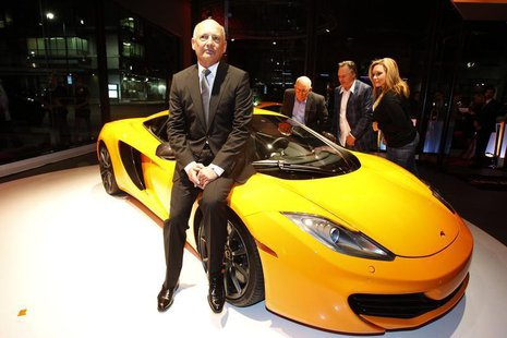 Ron Dennis, executive chairman of McLaren Automotive, sits on a MP4-12C during the opening of the first North American McLaren Automotive de