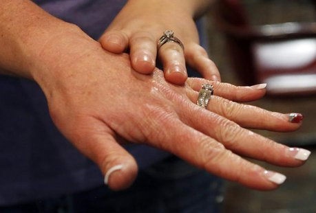 Shauna Griffen (L) and Brooke Shepherd show their rings after getting married at the Salt Lake County Government Building in Salt Lake City,