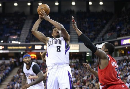 Sacramento Kings small forward Rudy Gay (8) shoots the ball against Portland Trail Blazers shooting guard Wesley Matthews (2) during the fou