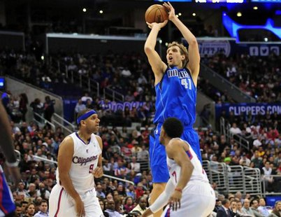 January 15, 2014; Los Angeles, CA, USA; Dallas Mavericks power forward Dirk Nowitzki (41) attempts a three point basket against the Los Ange