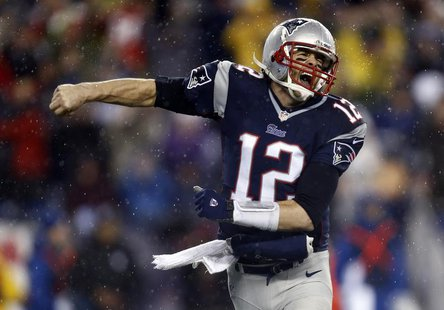New England Patriots quarterback Tom Brady (12) reacts after a touchdown against the Indianapolis Colts in the first half during the 2013 AF