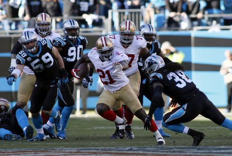 San Francisco 49ers running back Frank Gore (21) runs against Carolina Panthers strong safety Robert Lester (38) during the second half of t