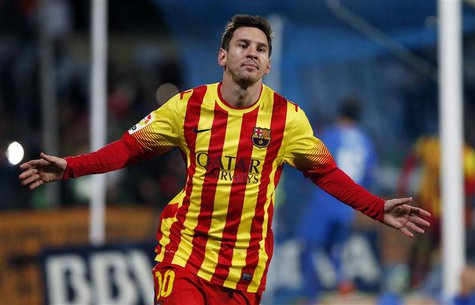 Barcelona's Lionel Messi celebrates after scoring his second goal against Getafe during their Spanish King's Cup soccer match at Colisseum A
