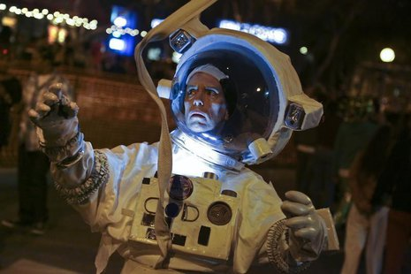 "Tom Coffey dresses as a character from the movie ""Gravity"" at the West Hollywood Halloween Costume Carnaval, which attracts nearly 500,000 p"