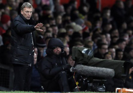 Manchester United's manager David Moyes instructs his team during their English Premier League soccer match against Swansea City at Old Traf