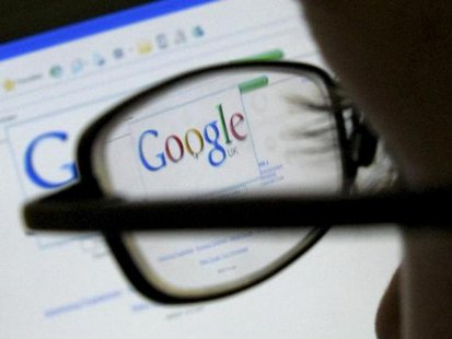 A Google search page is seen through the spectacles of a computer user in Leicester, central England July 20, 2007. CREDIT: REUTERS/DARREN STAPLES