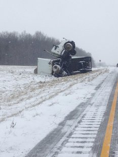 The tractor-trailer picture with the tractor standing upright is from the 30mm and no injuries reported.  provided by ISP 01-16-14