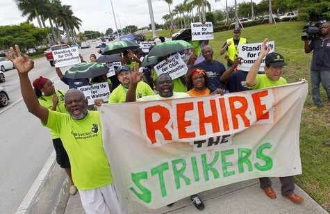 Walmart workers and supporters protest low wages outside one of the company's stores in Miami Gardens, Florida September 5, 2013. REUTERS/Jo