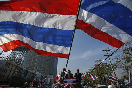 Anti-government protesters wave Thai national flags before marching towards the Public Health Ministry in Bangkok January 16, 2014. REUTERS/