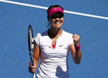 Li Na of China celebrates defeating Lucie Safarova of the Czech Republic during their women's singles match at the Australian Open 2014 tenn