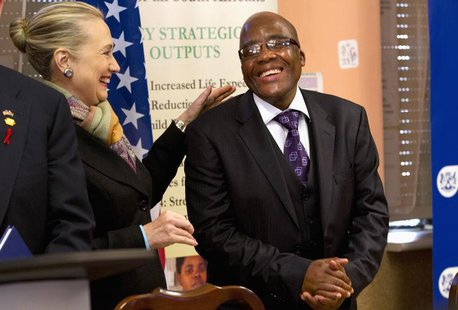 U.S. Secretary of State Hillary Clinton talks with South Africa's Health Minister Aaron Motsoaledi after attending a PEPFAR (U.S. President'