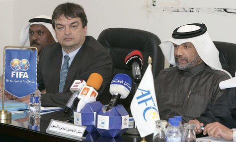 Asian Football Confederation's president, Mohammed Bin Hammam (R), and Jerome Champagne (2nd R) of FIFA, attend a meeting with Kuwaiti Clubs