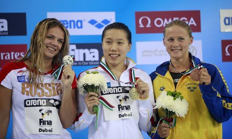 Gold medallist Liu Xiaoyu (C) of China poses with silver medallist Yulia Efimova (L) of Russia and bronze medallist Rebecca Ejdervik of Swed
