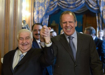 Syrian Foreign Minister Walid al-Moualem (L) and his Russian counterpart Sergei Lavrov enter a hall before the talks in Moscow, January 17,