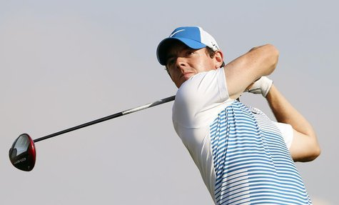 Rory McIlroy of Northern Ireland tees off on the 15th hole during the Abu Dhabi Golf championship January 17, 2014. REUTERS/Ahmed Jadallah