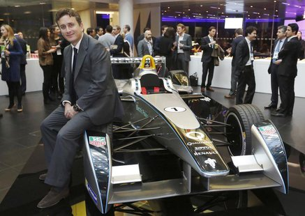 Alejandro Agag, CEO of Formula E Holdings, poses for a photograph with the Formula E car on display in London November 12, 2013. REUTERS/Luk