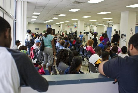 People fill the waiting area of a Pennsylvania Department of Transportation office in Philadelphia as they wait to get a voter ID card, Sept