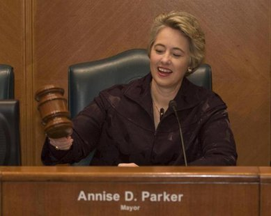 Houston Mayor Annise Parker wields the gavel to open her first session of City Council after being inaugurated in Houston January 4, 2010. R