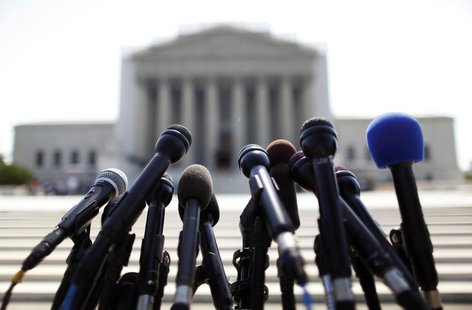 News microphones wait to capture reactions from U.S. Supreme Court rulings outside the court building in Washington, June 25, 2013. REUTERS/