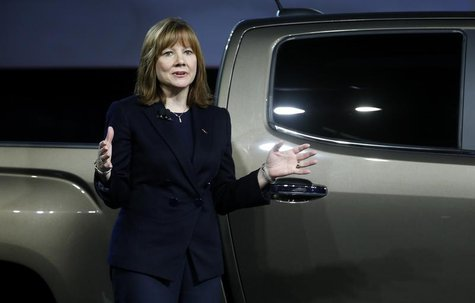 Mary Barra, incoming CEO of General Motors Co., reveals the 2015 GMC Canyon pickup truck in an industrial building in advance of the media p