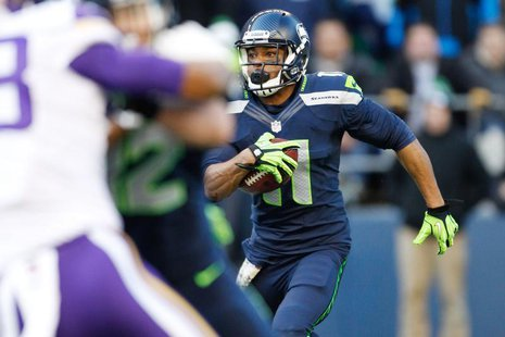 Nov 17, 2013; Seattle, WA, USA; Seattle Seahawks wide receiver Percy Harvin (11) returns a kickoff against the Minnesota Vikings during the