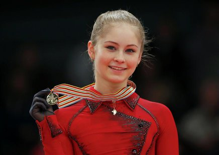 Gold medallist Julia Lipnitskaia of Russia poses during medal ceremony after the Ladies Free Skating event at the ISU European Figure Skatin