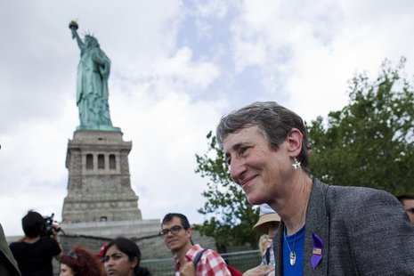 Secretary of the Interior Sally Jewell (R) takes a tour to the Statue of Liberty and Liberty Island during its reopening to the public in Ne
