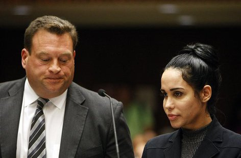 Nadya Suleman appears with her attorney Arthur J. La Cilento (L) for arraignment in Los Angeles, California January 17, 2014. REUTERS/Al Sei