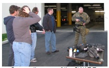 Citizen's Academy members learn more about the items used by a SWAT team.
