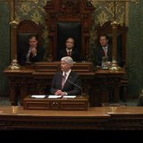 Governor Snyder with the Lt. Governor, the Speaker of the House and the Majority Leader of the Senate sitting behind him.