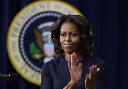 U.S. first lady Michelle Obama applauds as she gives remarks at an event on Expanding College Opportunity inside the Eisenhower Executive Of