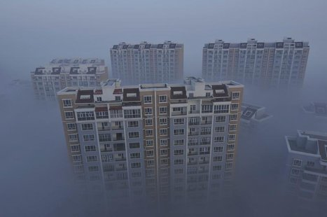A residential compound is seen during a smoggy day in Wujiaqu, Xinjiang Uighur autonomous region, November 19, 2013. REUTERS/Stringer