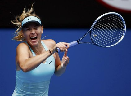 Maria Sharapova of Russia hits a return to Alize Cornet of France during their women's singles match at the Australian Open 2014 tennis tour