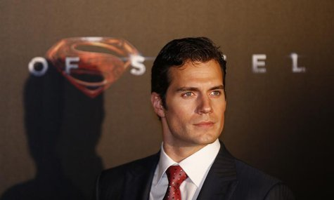 "Cast member Henry Cavill poses for pictures after his arrival to the Australian premiere of ""Man of Steel"" in central Sydney June 24, 2013."