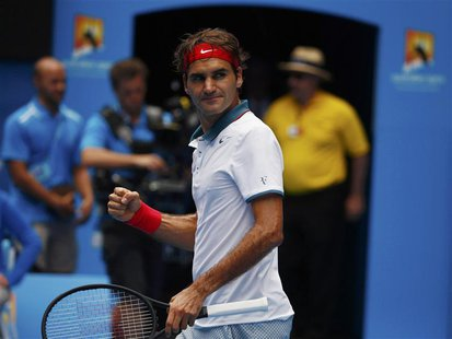 Roger Federer of Switzerland celebrates defeating Teymuraz Gabashvili of Russia during their men's singles match at the Australian Open 2014