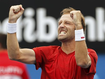 Stephane Robert of France celebrates defeating Martin Klizan of Slovakia during their men's singles match at the Australian Open 2014 tennis
