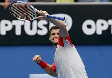 Grigor Dimitrov of Bulgaria celebrates defeating Milos Raonic of Canada during their men's singles match at the Australian Open 2014 tennis