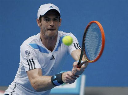 Andy Murray of Britain hits a return to Feliciano Lopez of Spain during their men's singles match at the Australian Open 2014 tennis tournam