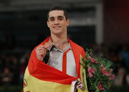 Gold medallist Javier Fernandez of Spain poses with medal after the Men Free Skating at the ISU European Figure Skating Championships in Bud