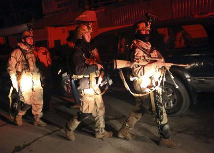 Afghan security forces arrive at the scene of an explosion in Kabul January 17, 2014. CREDIT: REUTERS/OMAR SOBHANI