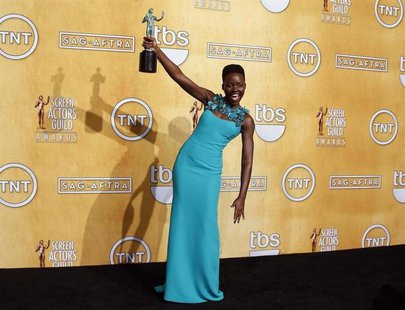 "Actress Lupita Nyong'o poses with her award for outstanding performance by a female in a supporting role for her role in ""12 Years a Slave"""