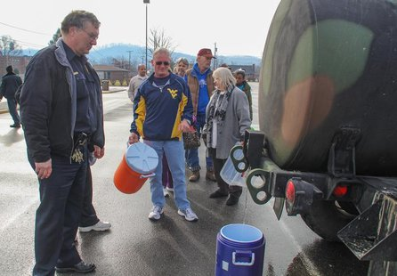 Residents line up for water at a water filling station at West Virginia State University, in Institute, West Virginia, January 10, 2014. REU