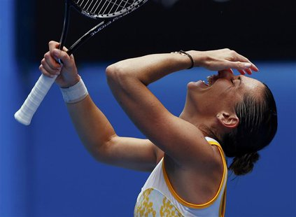 Flavia Pennetta of Italy celebrates defeating Angelique Kerber of Germany during their women's singles match at the Australian Open 2014 ten