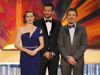 "Actors Amy Adams, Bradley Cooper (C) and Jeremy Renner introduce a clip from the film ""American Hustle"" at the 20th annual Screen Actors Gui"
