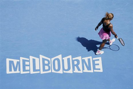 Serena Williams of the U.S. walks on the court during her women's singles match against Ana Ivanovic of Serbia at the Australian Open 2014 t