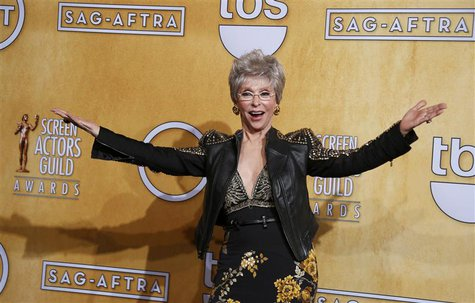 Actress Rita Moreno poses backstage after receiving her lifetime achievement award at the 20th annual Screen Actors Guild Awards in Los Ange