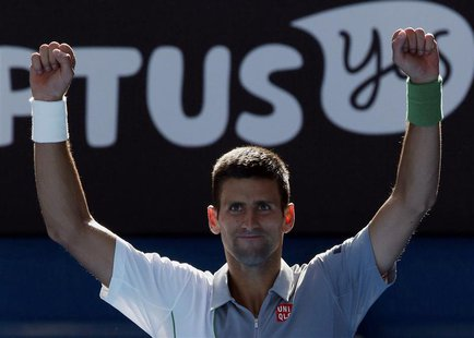 Novak Djokovic of Serbia celebrates defeating Fabio Fognini of Italy in their men's singles match at the Australian Open 2014 tennis tournam