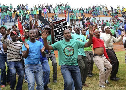 Members of South Africa's Association of Mineworkers and Construction Union (AMCU) attend a rally in Rustenburg, northwest of Johannesburg J