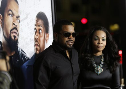 "Cast member Ice Cube and his wife Kimberly Woodruff pose at the premiere of ""Ride Along"" at the TCL Chinese theatre in Hollywood, California"