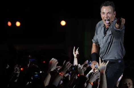U.S. singer Bruce Springsteen and the Street Band perform at the Rock in Rio Music Festival in Rio de Janeiro September 21, 2013 file photo.